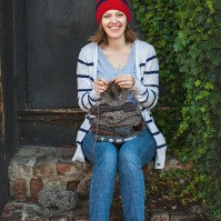 Robyn Devine getting her knit on and changing the world one hat at a time.