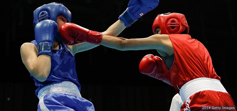 NANJING, CHINA - AUGUST 26:  Jajaira Gonzalez of United States (Red) fights against Ciara Ginty of Ireland (Blue).